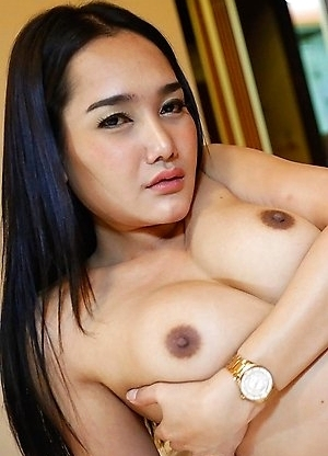 Beautiful Thai ladyboy Lily takes white cock up her ass