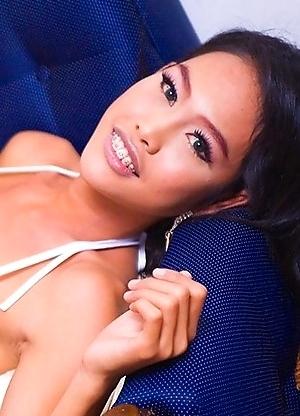 Sexy Katoey Wawa shows her ass in a tiny orange bikini