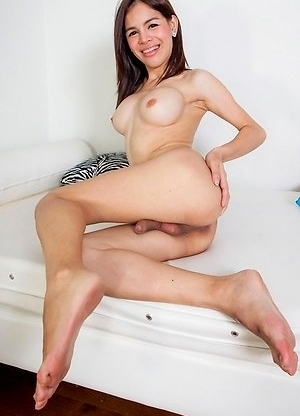 Lola is a fun 26 year old ladyboy. She always smiles and sometimes she likes to make weird faces. She has breast implants, a sexy uncut cock, nice hai