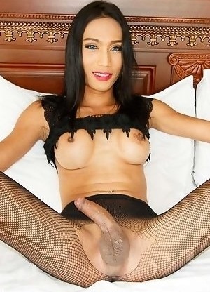 Tall, tight-bodied, blue-eyed Natty is wearing a little black blouse and pantyhose with a little heart-shaped cut out just above her asshole