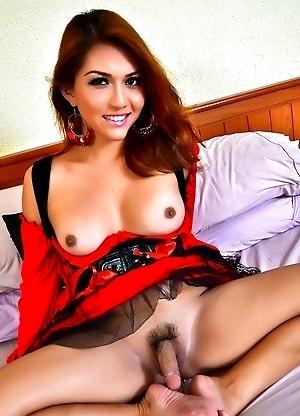 Feminine Exotic Shemale milking her penis on her own Feet