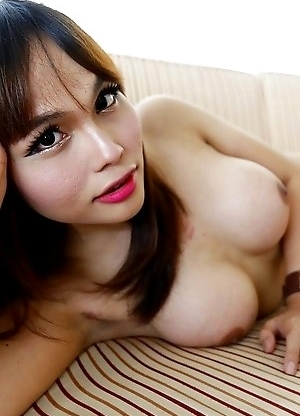 23yo busty Thai newhalf Ayumi does a striptease for white tourist