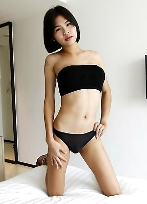 21yo busty Thai shemale Gogo strips for the camera to tease her white cock date