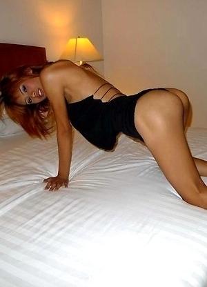 Cute Asian Ladyboy posingon bed