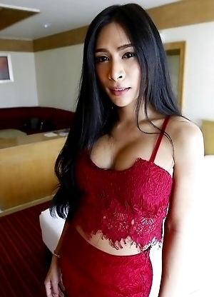 25yo busty Thai shemale Pang strips down to her big tits and cock for her white date