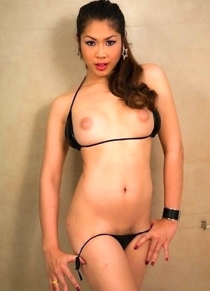 Wet black bikini pulled side for Ladyboy Sakura pleasure