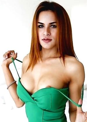 23yo busty Thai shemale Nuni does a striptease for white tourist