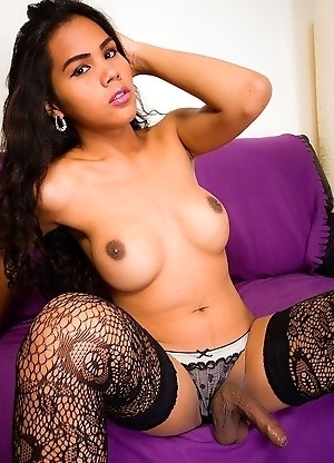 Kate is an absolutely beautiful 20 year old Cambodian ladyboy. She has a great dark skin, beautiful and wild curly hair and a smoking hot face. She is