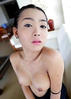 22 year old busty Thai ladyboy Samy gets naked and poses for tourist