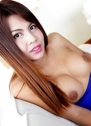 Busty Thai ladyboy Nadea strips to her big boobs and bare cock