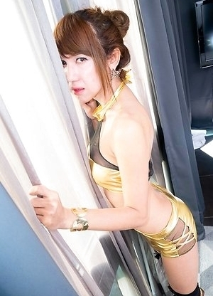 Ladyboy Nanny gets changed from her short grey dress into gold booty shorts and matching top.