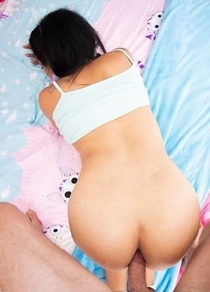 Ladyboy Paeng is by the window wearing a baby blue blouse and pink panties with pigtails and kitty cat ears.